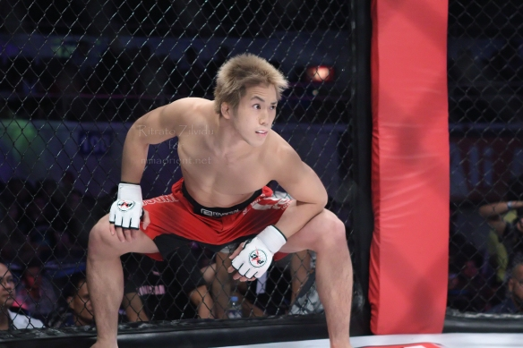 Michinori Tanaka stares at Russel Doane during their fight at PXC 34