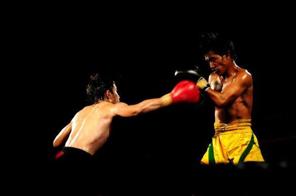 Pacio (red short) and Bagayao (yellow short) in action. Photo by Stiff Bhani for Team Lakay