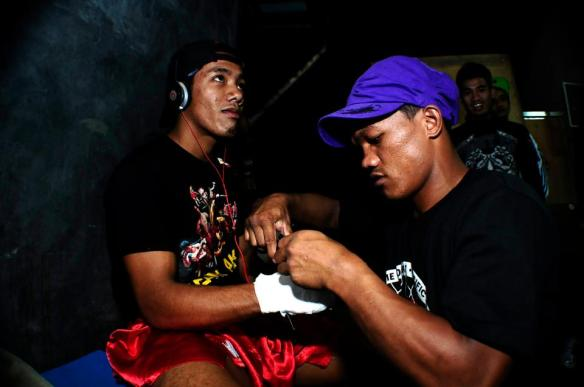 Troy getting his hands wrapped by his teammate Jerome Wanawan. Photo by Stiff Bhani for Team Lakay