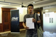 The younger Kelly, Edward, shown here with his new contract with One FC