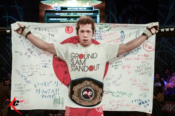 (PXC Champ Poses After His PXC 37 Win over Pitpitunge) Photo by PXC