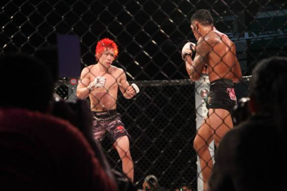 Tanaka and Aguon's very looks cautious in the second round of their PXC 40 fight - Photo by 671mma.com